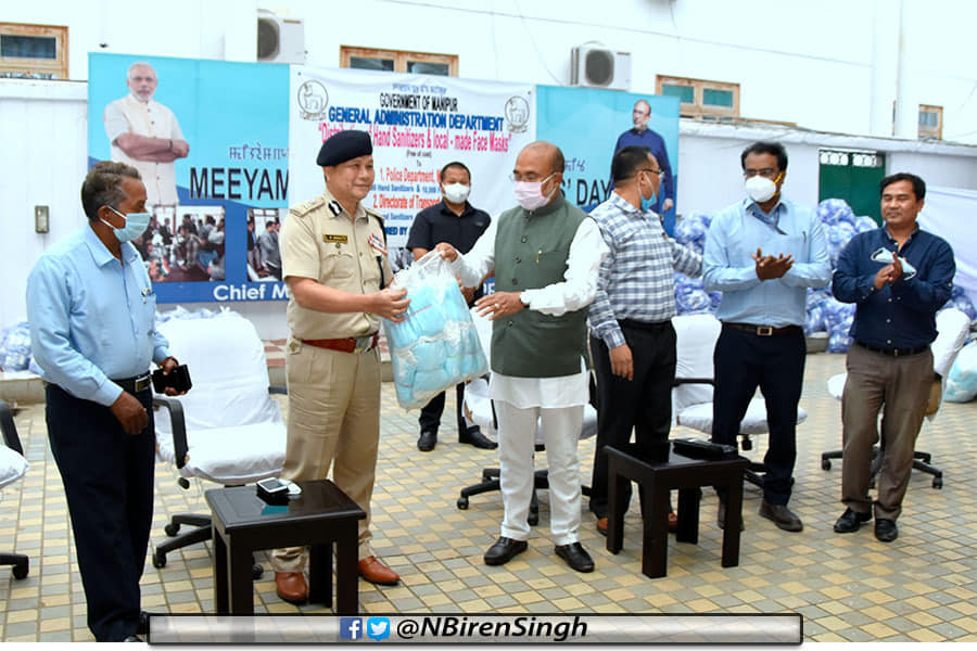 CM hands over hand sanitizers, face masks