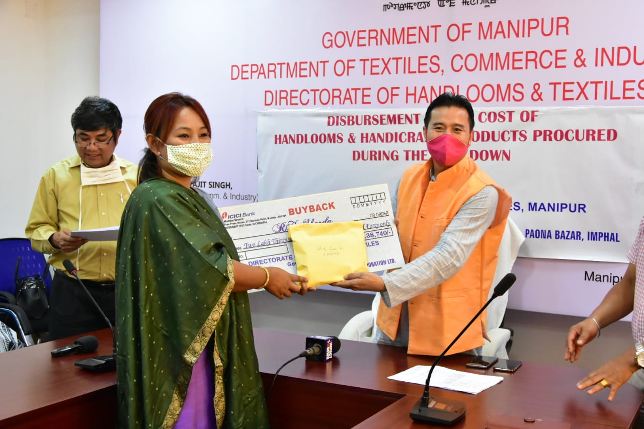 Min Biswajit hands out cost of handloom and handicraft products procured during lockdown